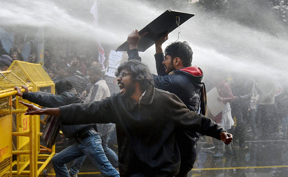 Police use water cannons to disperse students during a protest against the Ministry of Human Resource Development in New Delhi on Monday over the suicide of a PhD scholar Rohith Vemula at University of Hyderabad. PTI