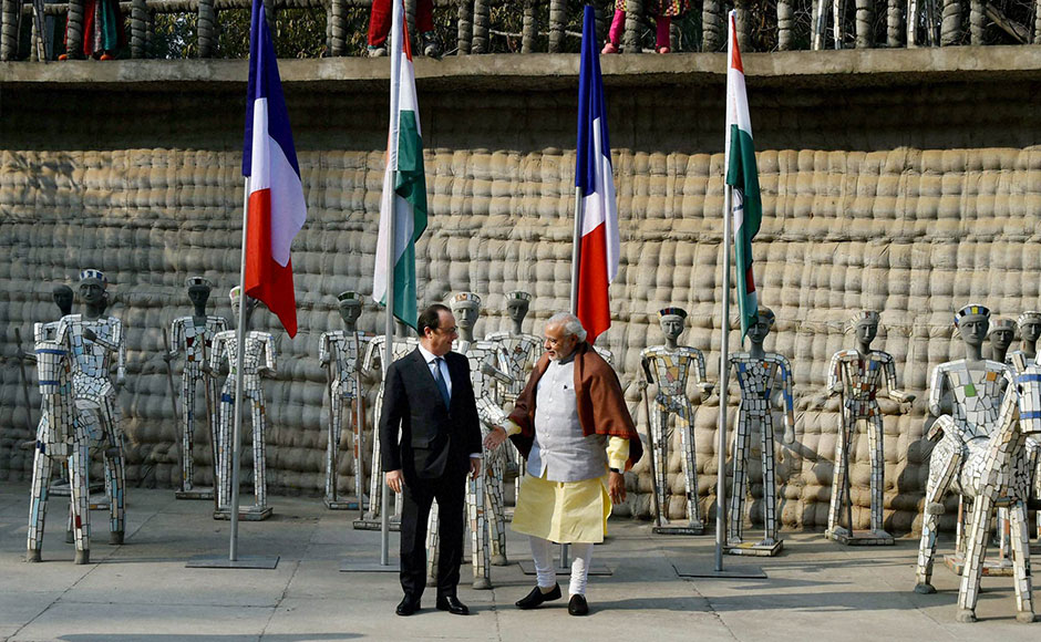 Chandigarh: French President Francois Hollande and Prime Minister Narendra Modi at the Rock Garden of Chandigarh on Sunday. PTI Photo by Atul Yadav