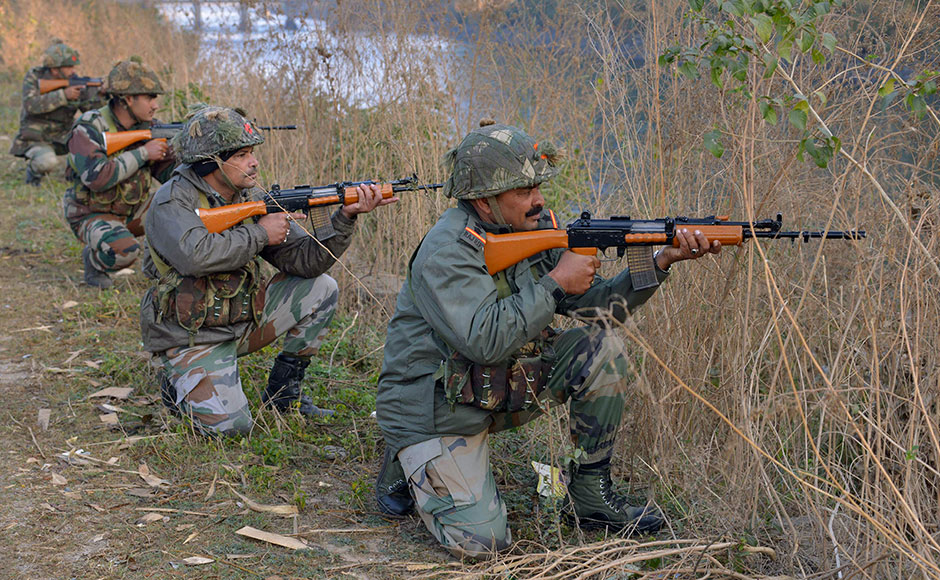 "Indian army soldiers take up position on the perimeter of an airforce base in Pathankot on January 3, 2016, during an operation to 'sanitise' the base following an attack by gunmen. The deadly assault on an Indian air base near the Pakistan border was ""a heinous"" terrorist attack, the United States said, urging the two rivals to work together to hunt down those responsible. Three security officers were killed in the attack by suspected Islamist militants on Pathankot base in northern Punjab state early January 2. At least four attackers also died in shootouts with security forces. AFP PHOTO/NARINDER NANU"