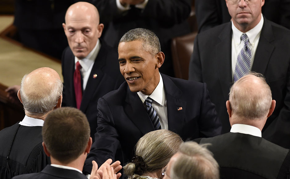 US President Barack Obama arrives to deliver the State of the Union Address during a Joint Session of Congress at the US Capitol in Washington, DC, January 12, 2016. AFP PHOTO / SAUL LOEB / AFP / SAUL LOEB