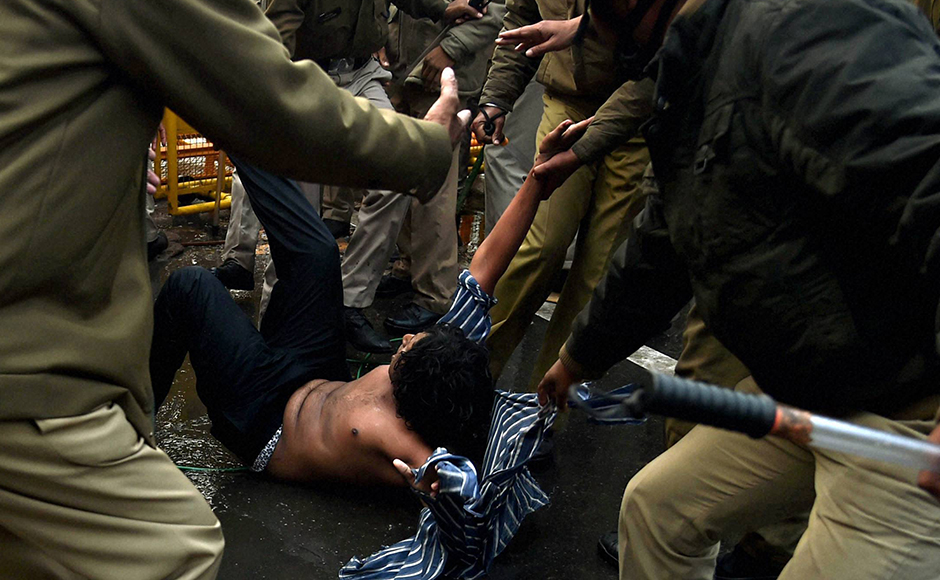Police detain students during a protest against the Ministry of Human Resource Development in New Delhi on Monday over the suicide of a PhD scholar Rohith Vemula at University of Hyderabad. PTI