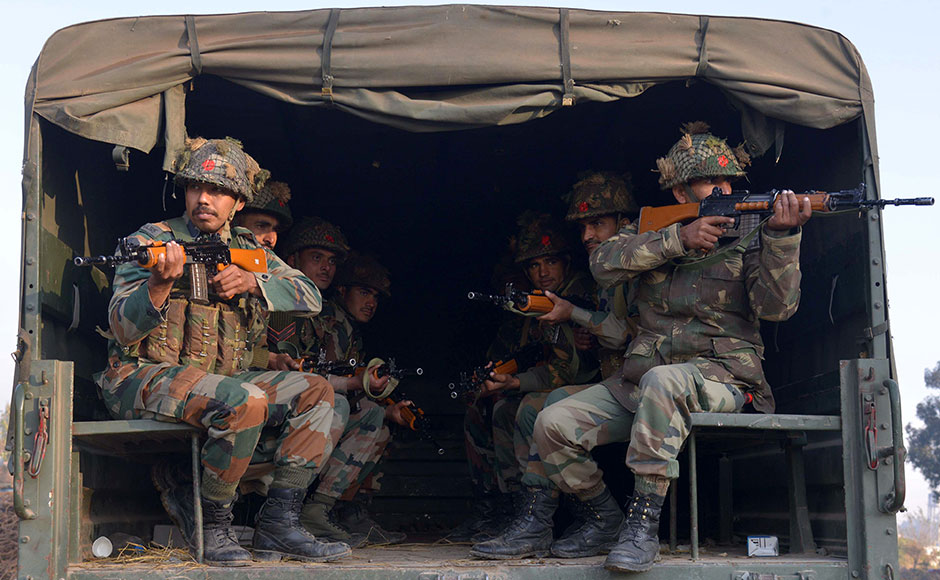 "Indian army personnel sit in the rear of a truck at an airforce base in Pathankot on January 3, 2016, during an operation to 'sanitise' the base following an attack by gunmen. The deadly assault on an Indian air base near the Pakistan border was ""a heinous"" terrorist attack, the United States said, urging the two rivals to work together to hunt down those responsible. Three security officers were killed in the attack by suspected Islamist militants on Pathankot base in northern Punjab state early January 2. At least four attackers also died in shootouts with security forces. AFP PHOTO/NARINDER NANU"