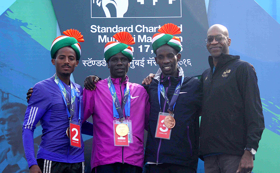 Legendary American athlete Edwin Moses with Second-placed runner Seboka Dibaba, (L), winner Gideon Kipketer (C) and third-placed Marius Kimutai after the Standard Chartered Mumbai Marathon 2016 in Mumbai, India on January 17, 2016. (Pravin Utturkar/SOLARIS IMAGES)