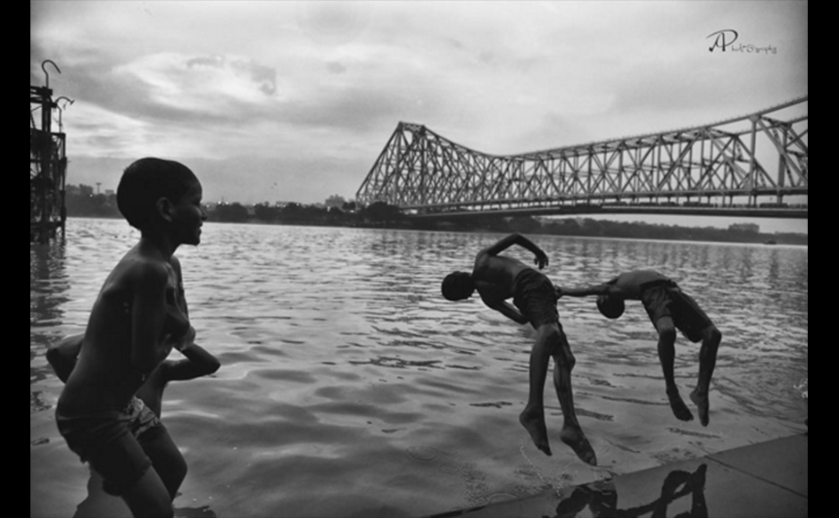 The photograph was shot at Mullick Ghat, Howrah, Kolkata during summer. In this image, we see local children playing and jumping into the Ganges, in front of the Howrah bridge. Arpita Pramanick, 24 years, Graphic Designer