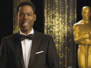 Chris Rock in the Oscar promo. Screenshot from YouTube video.