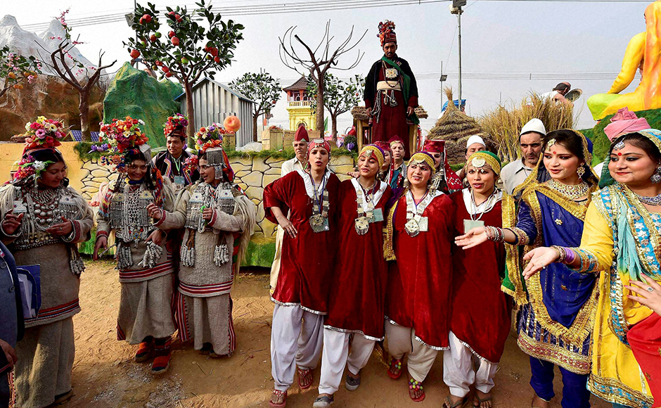 Jammu and Kashmir artists pose in front of their tableau for the Republic Day parade during a press preview in New Delhi on Friday. PTI Photo by Kamal Kishore