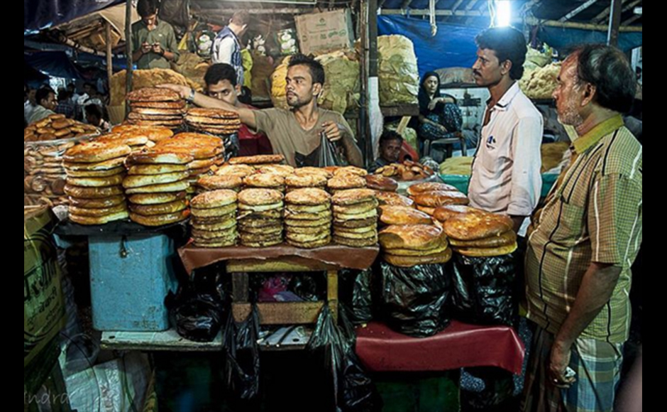 This shot was taken on one of Indrajit's foodwalks during the time of Ramzan in 2015 in the Chitpur area, near Nakhoda Masjid. The person pictured is selling a very famous bread variety (mostly available during Ramzan time) named Sheermal and Bakarkhani to his eager customers. Indrajit Lahiri, 38 years, Business Consultant (IT)