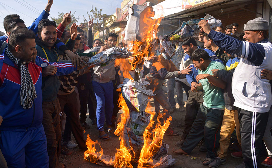 Indian residents set fire to an 'effigy' on a road leading to an airforce base in Pathankot on January 2, 2016, during an ongoing attack on the base in the northern Indian state of Punjab by suspected militants. Suspected Islamist gunmen have staged a pre-dawn attack on a key Indian air base near the Pakistan border with two militants killed in a shootout, officials said, striking a blow to the neighbours' fragile peace process. AFP PHOTO/NARINDER NANU