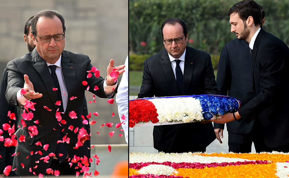 French President Francois Hollande (C) throws rose petals as he pays tribute at Raj Ghat -- the memorial to the father of the Indian nation Mahatma Gandhi -- in New Delhi on January 25, 2016. After beginning a three-day visit to India in the northern city of Chandigarh on January 24, French President Francois Hollande has headed to the capital New Delhi to make common cause with India's Prime Minister Narendra Modi on issues such as combating Islamist extremists and climate change. AFP PHOTO / Money SHARMA