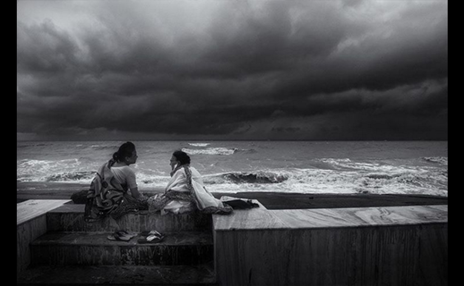 Madhabendu shot this image back in 2014 monsoon when he visited Digha, a beach in West Bengal. Digha is one of the most tourist-friendly places in West Bengal. Though it's overcrowded, he found these two ladies beside the sea. They ignored him, just as they ignored the drizzle. He found this moment pretty interesting. Madhabendu Hensh, 29 years, Photographer