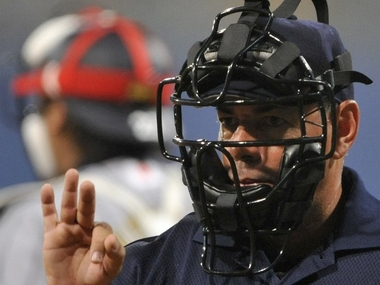 Cricket must take cue from baseball where umpires wear protective gear. AFP