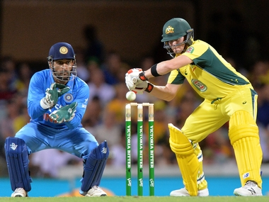 MS Dhoni and Steve Smith in action in Brisbane. Getty