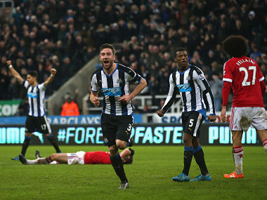 Paul Dummett celebrates as he scores their third and equalising goal during the Barclays Premier League match between Newcastle United and Manchester United. Getty