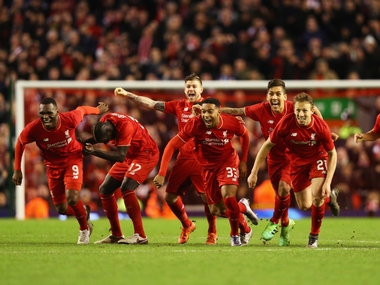 Liverpool celebrate after edging Stoke City 6-5 on penalties. Getty