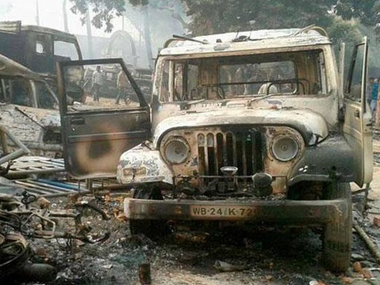 One of the torched vehicles in Malda violence. - PTI