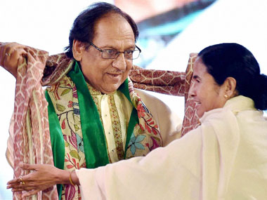 West Bengal Chief Minister Mamata Banerjee honours Ghazal maestro Ghulam Ali at a programme in Kolkata on Tuesday. PTI