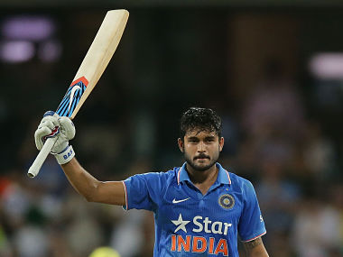 Manish Pandey celebrates and acknowledges the crowd after scoring a century in the 5th ODI. Getty