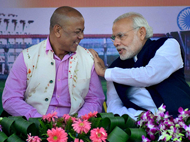 Prime Minister Narendra Modi with Chief of Bodoland Peoples' Front (BPF) Hagrama Mohilary during a public meeting ahead of Assam assembly election in Kokrajhar, Assam. PTI