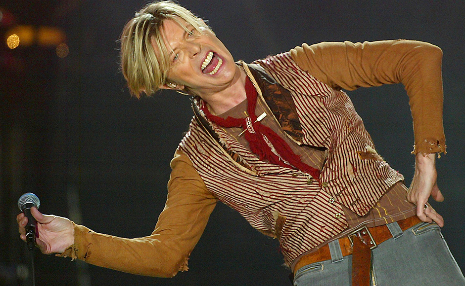 British singer David Bowie performs during the first concert of his UK tour in Manchester, November 17, 2003. Reuters
