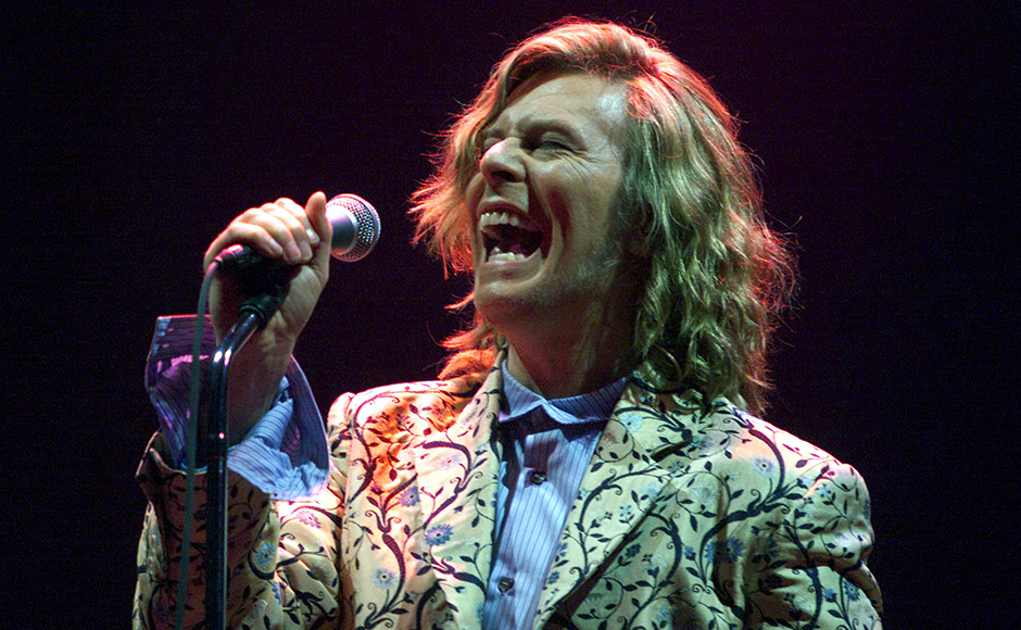 """Rock star David Bowie, shown performing at the Glastonbury Festival on June 25, 2000, has been crowned the musician's musician, according to a year-long survey conducted by the British weekly New Music Express, released November 27, 2000. Bowie beat the Beatles and alternative rockers """"Radiohead"""" in the survey that asked hundreds of top rock and pop stars to name their biggest musical influence. Reuters"""