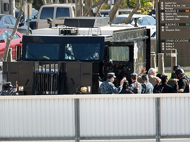 People are directed to come out of buildings on the campus of Naval Medical Center San Diego. AP