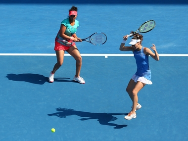 Sania Mirza and Martina Hingis in action at the Australian Open. Getty