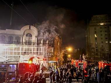 Smoke rises as Iranian protesters set fire to the Saudi embassy in Tehran. AP