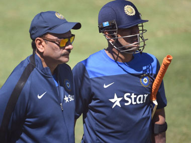 File photo of Ravi Shastri and MS Dhoni. AFP