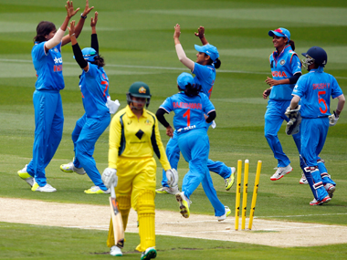 Indian team celebrates the fall of an Australian wicket. Getty Images