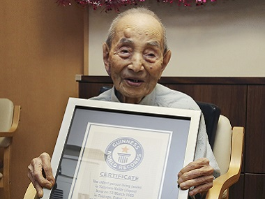File image of Yasutaro Koide, 112, holding the Guinness World Records certificate after being recognised as the world's oldest man. AP