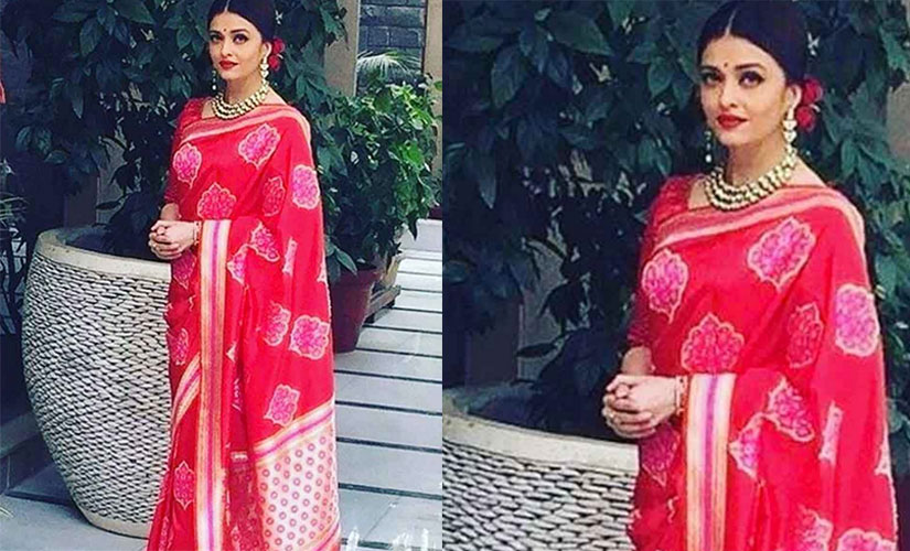 Aishwarya in red to meet Hollande/ IBN live
