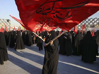 "Iranian women wave flags that read, ""Death to America and we shall never accept humiliation,"" during a rally to protest the execution by Saudi Arabia last week of Sheikh Nimr al-Nimr. AP"