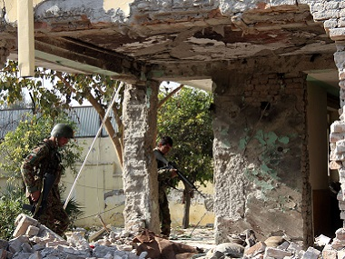 Afghan security forces inspect a building, used by insurgents to launch an attack on Pakistan's consulate in Jalalabad. AP