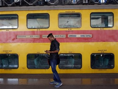 An Indian traveller uses a free WiFi service to browse the net at Mumbai Central Train Station in Mumbai, India. AP Photo