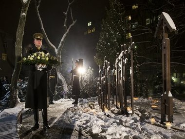 Lithuanian Army solders take part in a wreath laying ceremony on the eve of the 25th anniversary of the Day of the Defenders in Vilnius, Lithuania. AP