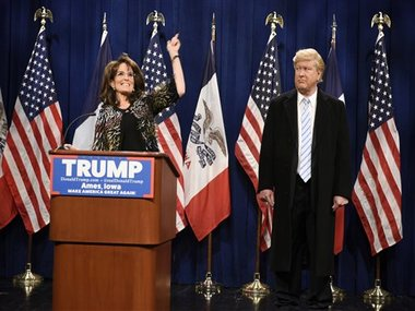 "This Saturday, January 23, image provided by NBC shows Tina Fey, left, as Sarah Palin and Darrell Hammond as Donald Trump on ""Saturday Night Live."" AP"