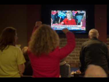 Staff and volunteers of the Hillary Clinton Burlington, Iowa campaign field office cheer as Hillary Clinton speaks on the television. AP