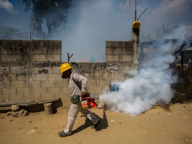 An employee of the Health Secretariat fumigates against the Aedes aegypti mosquito to prevent the spread of the Zika. AFP
