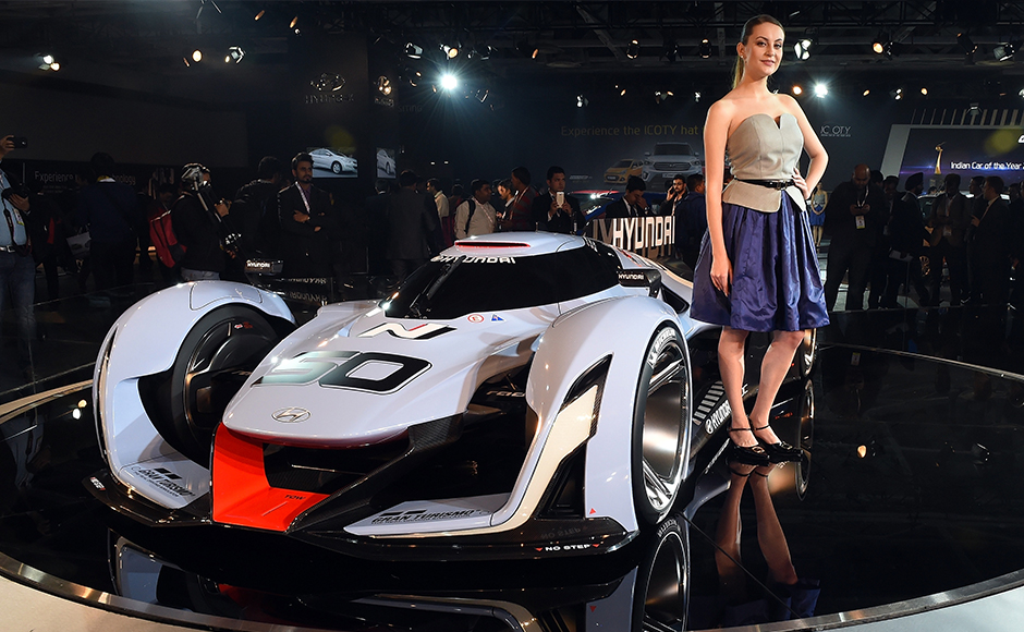 An model poses with Hyundai's concept car at the Indian Auto Expo 2016, in Greater Noida on the outskirts of New Delhi on February 3, 2016. India's flagship auto show opened its doors in New Delhi on February 3, with a new batch of diesel-guzzling SUVs on proud display despite industry uncertainty over a pollution crackdown targetting motorists in the capital. AFP PHOTO / Prakash SINGH