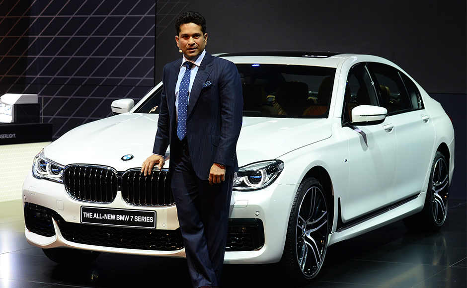 Indian former cricketer Sachin Tendulkar poses with the newly launched BNW 7 series at the Indian Auto Expo 2016 in Greater Noida on the outskirts of New Delhi on February 3, 2016. India's flagship auto show opened its doors in New Delhi February 3, with a new batch of diesel-guzzling SUVs on proud display despite industry uncertainty over a pollution crackdown targetting motorists in the capital. AFP PHOTO / SAJJAD HUSSAIN