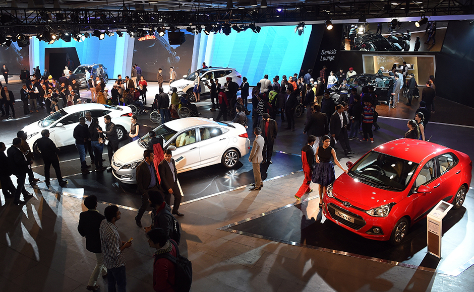 Visitors gather at Hyundai's pavilion at Auto Expo 2016 in Greater Noida some 45kms east of New Delhi on February 4, 2016. India's flagship auto show opened its doors in New Delhi with a new batch of diesel-guzzling SUVs on proud display, despite industry uncertainty about a pollution crackdown targeting motorists in the capital. More than 80 vehicle launches were expected at the Auto Expo 2016, the biggest edition in the show's 30-year history, with the Fiat Chrysler-owned Jeep making its India debut and hoping to capitalise on the popularity of sports utility vehicles. AFP PHOTO / Prakash SINGH