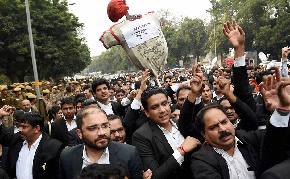 New Delhi: Lawyers carry an effigy as they march from Patiala House Courts to India Gate against alleged anti-national activities at JNU, in New Delhi on Friday. PTI Photo by Atul Yadav