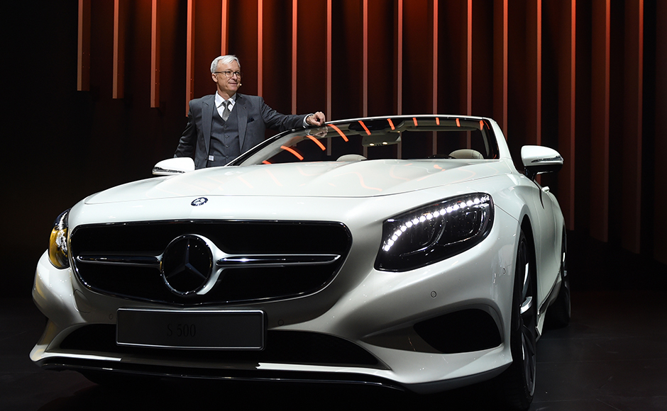 Roland Folger, managing director and CEO of Mercedes Benz India, poses with the S500 Mercedes Benz car at the Indian Auto Expo 2016 in Greater Noida on the outskirts of New Delhi February 3, 2016. India's flagship auto show opened its doors in New Delhi February 3, with a new batch of diesel-guzzling SUVs on proud display despite industry uncertainty over a pollution crackdown targetting motorists in the capital. AFP PHOTO / SAJJAD HUSSAIN
