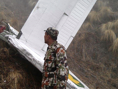 An army officer at the crash site. AFP