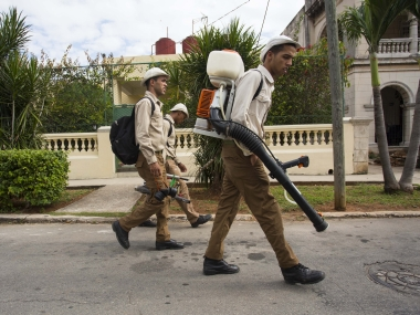 Government fumigators prepare to spray homes for mosquitos in Havana, Cuba. AP