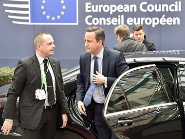 British Prime Minister David Cameron arrives for an EU summit at the EU Council building in Brussels on Thursday. AP