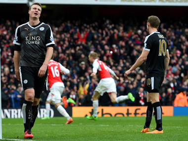 Leicester City players look dejected after conceding a goal against Arsenal at The Emirates on Sunday. Getty