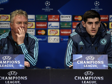 Chelsea'smanager Guus Hiddink and goalkeeper Thibaut Courtois on the eve of the match. AFP
