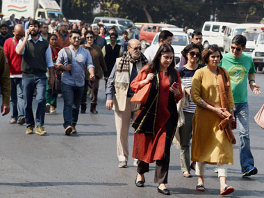 Journalists display placards at a protest march from Press Club of India to the Supreme Court in protest against the Monday's attack on media persons and JNU students by lawyers outside and inside Patiala House Courts, in New Delhi on Tuesday. PTI