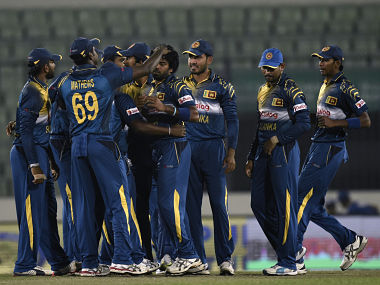 Sri Lankan cricketers congratulate their captain Lasith Malinga (C) after the dismissal of the Rohan Mustafa. AFP